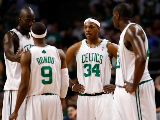 Boston Celtics forward Paul Pierce (34) talks with