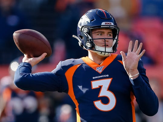 Drew Lock warms up before the Denver Broncos game against the Los Angeles Chargers on Dec. 1, 2019.