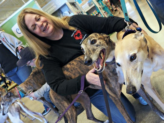 Rhea Behlke, of Fond du Lac, poses with Jess, at left,