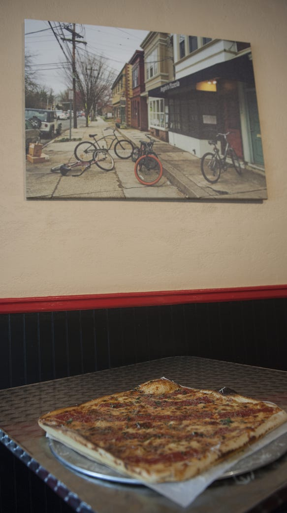 Angelo's specialized is in thin-crust, pan pizza, but