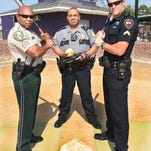 From left, Alonzo Ned,k Jody White and Channing Credeur prepare for the Police Baseball World Series to be held in Las Vegas.