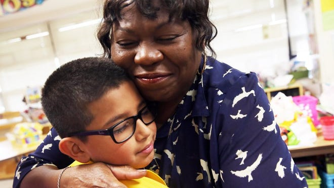 """Arlene Desmore, 62, hugs third-grader Jordan Mendoza as she says goodbye to her class on the last day of school at Village Oaks Elementary in Immokalee on Tuesday. Desmore is retiring after 40 years of being an elementary school teacher. """"My last year and everyone is going on to the fourth grade,"""" she says. """"That's wonderful."""