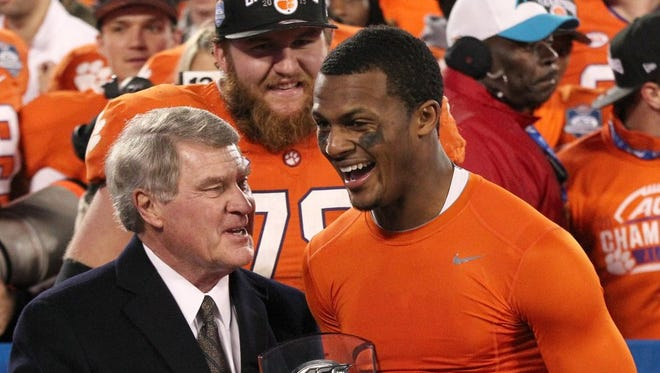 ACC commissioner John Swofford (left) awards Clemson quarterback Deshaun Watson the MVP Trophy after the 2015 ACC championship game in Charlotte, North Carolina.