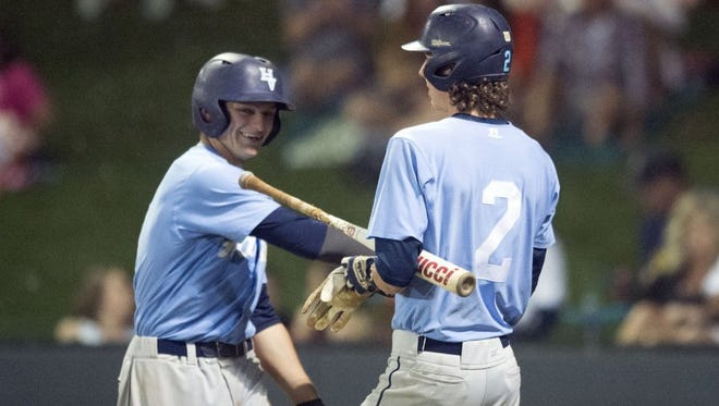 Hardin Valley's Ryder Green, left, and Tyler Thompson celebrate during the game against Farragut in the District 4-AAA tournament on Monday, May 9, 2016.