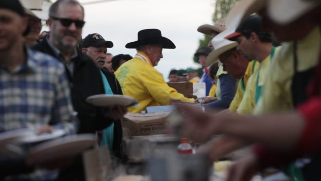 Dale Kendall, center, Asphalt Cowboys breakfast chairman, works the pancake breakfast at a previous pancake breakfast in downtown Redding.