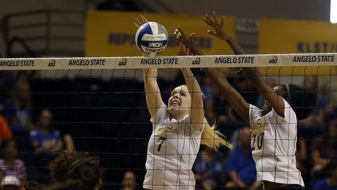 Angelo State's Abbie Lynn and Leiyona Young elevate for a block last year. Both players are back for their senior season.
