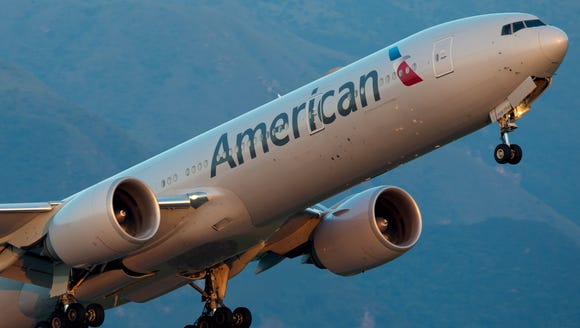 An American Airlines Boeing 777-300 takes off from