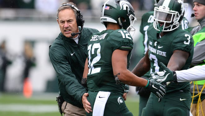 Michigan State football coach Mark Dantonio, left, celebrates with R.J. Shelton after Shelton's first-half touchdown against Purdue during the Spartans' 24-21 2015 win in East Lansing.