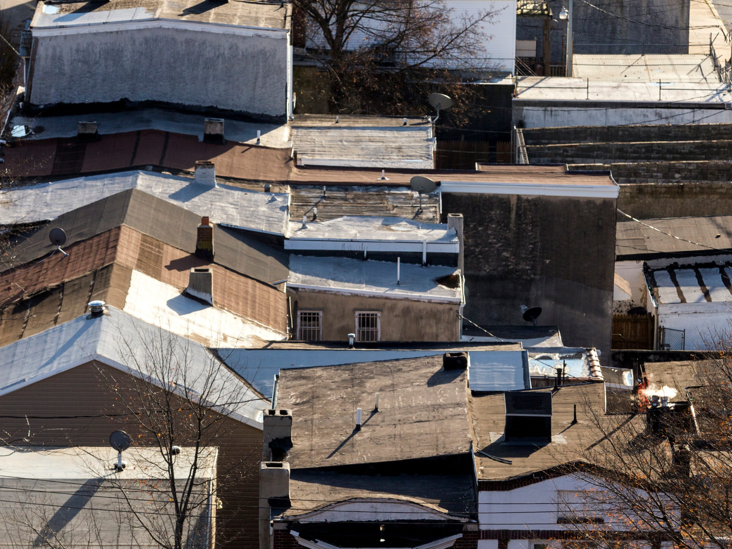 A patchwork of roofs of homes in West Center City can be seen from the bell tower of the Sacred Heart Oratory on Thursday afternoon.