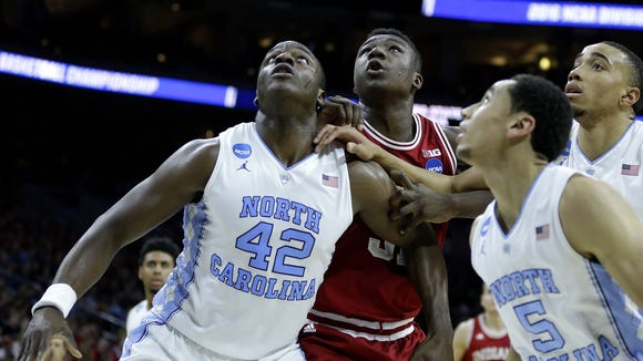 Hoosiers center Thomas Bryant (31) fights for position against Tar Heels forward Joel James (42) at the Wells Fargo Center on March 25, 2016.