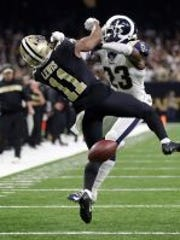 Rams defensive back Nickell Robey-Coleman (23) drills Saints wide receiver Tommylee Lewis during a third-down pass near the end of last month's NFC Championship Game. A referee who has local ties has come under fire for not calling pass interference on the play. (Photo: Gerald Herbert/AP)