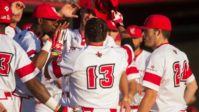 UL's Brenn Conrad celebrates with teammates after scoring against Northwestern State in the second inning.