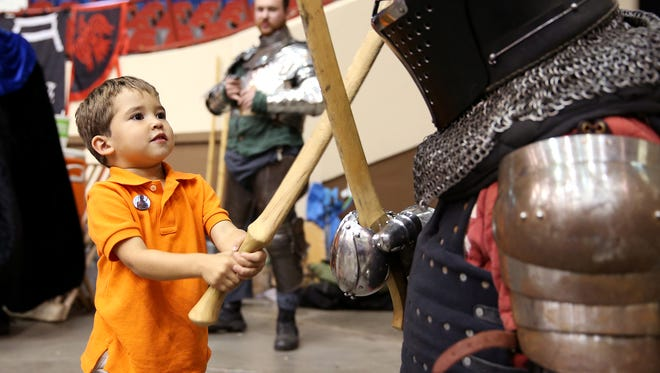 Stephen Nance, 3, fights a knight Oct. 1, 2016, at San Angelo Comic Con.