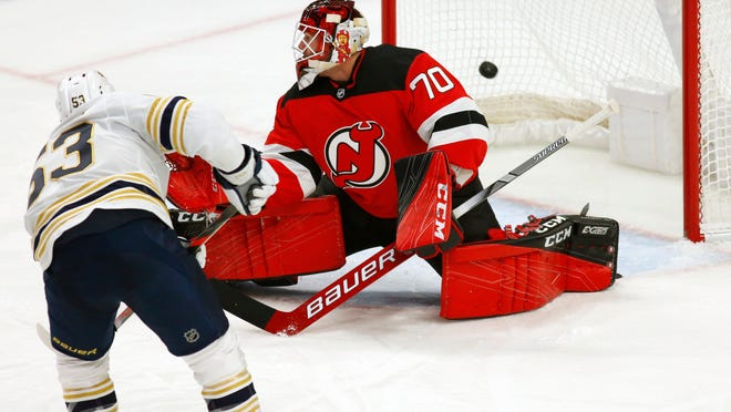 Buffalo Sabres forward Jeff Skinner (53) puts the puck past New Jersey Devils goalie Louis Domingue (70) during the first period of an NHL hockey game Monday, Dec. 2, 2019, in Buffalo, N.Y. (AP Photo/Jeffrey T. Barnes)