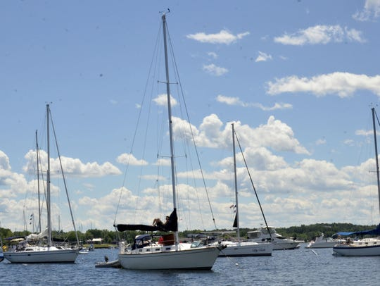 Boats moor in Burlington's harbor on Sunday in anticipation