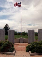 Old glory flies above the Larimer County Veterans Memorial at Edora Park Sunday May 24, 1998.