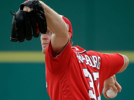 FILE - In this March 5, 2016, file photo, Washington Nationals starting pitcher Stephen Strasburg throws between innings during a spring training baseball game against the Detroit Tigers. (AP Photo/John Raoux, File)