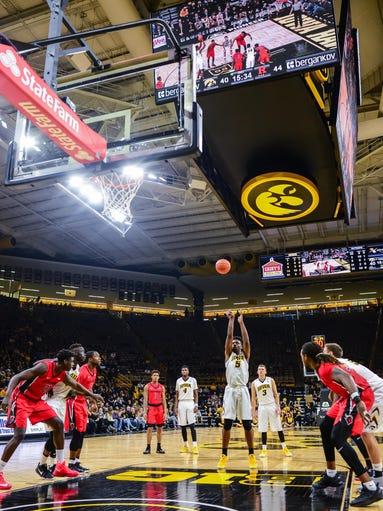 Iowa Hawkeyes forward Tyler Cook (5) shoots a free