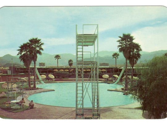 View of high dive platform and pool in background.