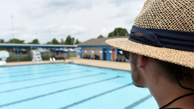 Lifeguard Benson Guinn keeps an eye on swimmers at the Mountain Home City Pool. The pool opened its full schedule of swim classes, aerobic classes and open swims Monday.