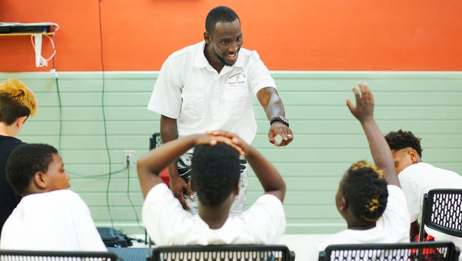 Erick Walker leads a Transformers Club meeting recently at the STARS Complex in the Dunbar community of Fort Myers. The Christianity based club aims to help at-risk youth.