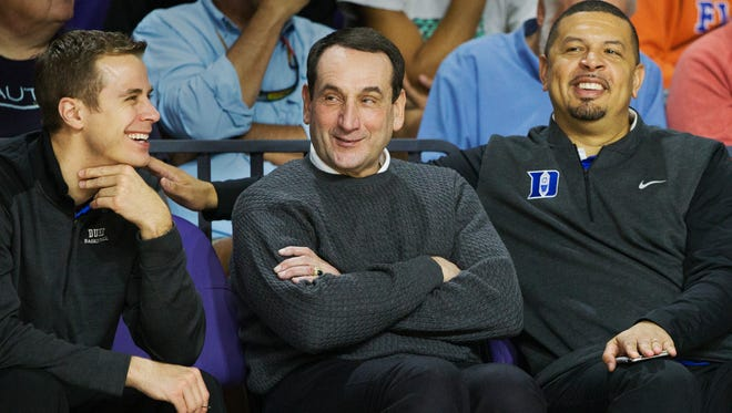 Duke University men's basketball coach Mike Krzyzewski, center, and assistant coaches Jon Scheyer, left, and Jeff Capel take in games Friday at the Culligan City of Palms Classic at the Suncoast Credit Union Arena in Fort Myers.