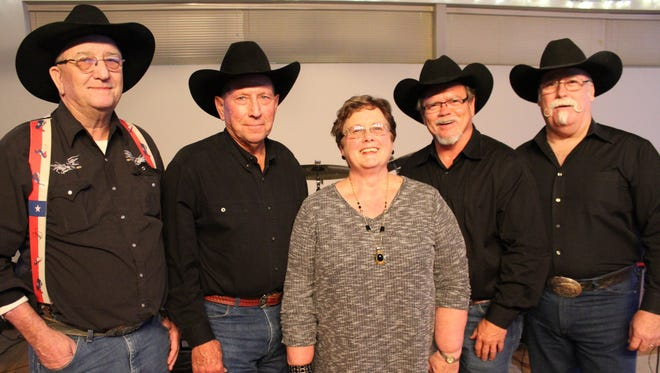 From left: Muddy Creek is Gary Sanders, fiddle; Dwaine Burns, steel; Karen Shelnutt, keyboards; Pat Carriker, drums; and Jimmy Dokey, bass. The band is playing its last dance Saturday evening in Oplin.