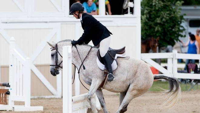 An equestrian horse refuses to jump over a hurdle at the 2016 Ozaukee County Fair in Cedarburg.
