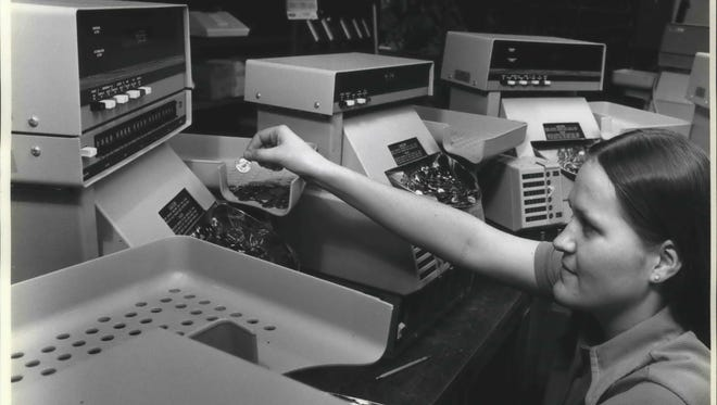 This 1979 photo first ran when the Susan B. Anthony dollar coin was scheduled to enter the nation's monetary system, which kept testing facilities busy at Brandt, Incorporated. The Watertown company was a leading producer of automatic coin sorter-counters with digital readouts. It was changing from five coin to six coin equipment throughout its product line for bankers and other large volume money handlers. The United States Mint  provided Brandt with sample dollar coins to mix in with pennies, nickels, dimes, quarters and half dollars for test purposes.