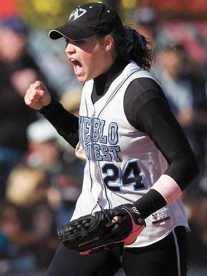 Former Pueblo West High School and BYU standout, turned CSU-Pueblo head coach Christie Koshke (then Christine Zinanti) celebrates one of two consecutive Class 4A state softball titles in 2004 and 2005.