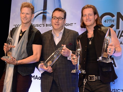 Florida Georgia Line, winners of Vocal Duo and Best Single for Cruise with producer Joey Moi, center, in the press room.