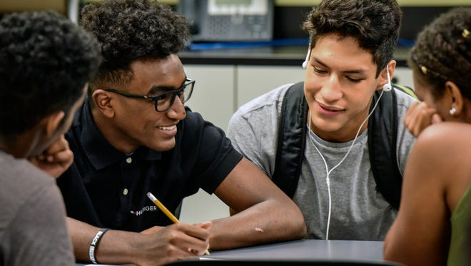 """Annandale High students confer over an exercise involving """"fake news."""""""
