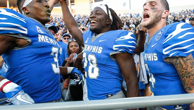 Memphis teammates (from left) Anthony Miller, Doroland Dorceus and Riley Ferguson celebrate a 30-27 victory over Navy on Oct. 14.