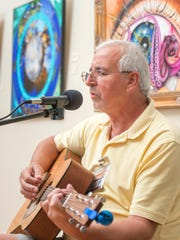 G.W. Bohn performs during the weekly Panhandle Folk Music Club meeting at the Artel Gallery in Pensacola on Wednesday, April 5, 2017.