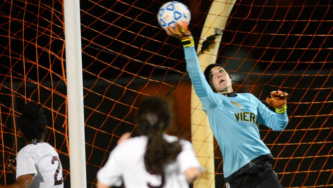 Sydney Lau of Viera makes a save during last Friday's Class 4A state soccer final. Lau was voted FLORIDA TODAY's Athlete of the Week for Feb. 1-7.