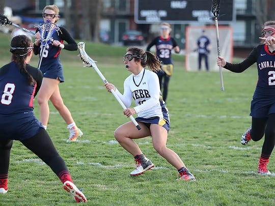 Murfreesboro's Leann Faour, center, competes in a recent game for The Webb School. Faour has been selected as a member of the Tennessee team that will compete in the U.S. Lacrosse Association Division National Tournament later this month.