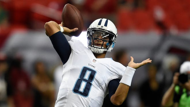 Titans quarterback Marcus Mariota (8) warms up before a preseason game against the Falcons on Friday at the Georgia Dome in Atlanta.