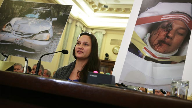Stephanie Erdman of Destin, Fla., who was seriously injured by the airbag explosion in her Honda Civic during a traffic accident last year, testifies during a hearing before the Senate Commerce, Science and Transportation Committee into the air bag problems on Nov. 20.