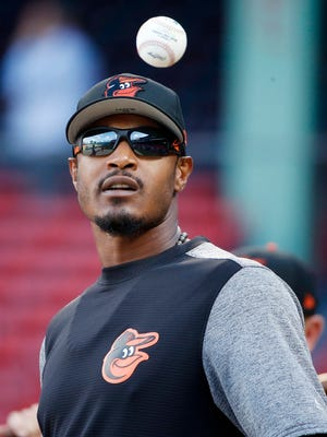 Orioles' Adam Jones warms up before Tuesday's game at Fenway Park.