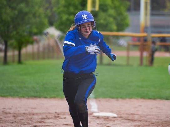 Harper Creek's Jamie Shreve runs home during their