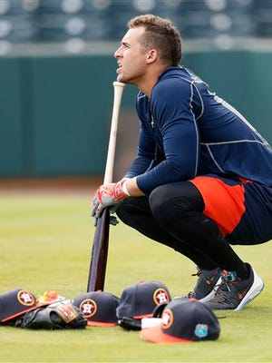 Houston Astros' George Springer waits his turn during batting practice for position players on the main field during baseball spring training in Kissimmee, Fla.