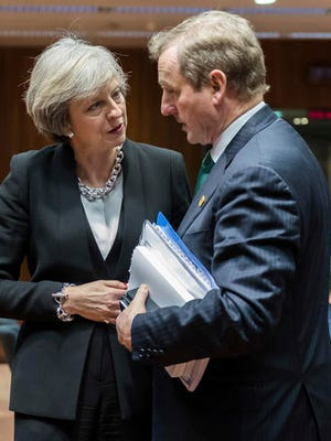British Prime Minister Theresa May, left, speaks with Irish Prime Minister Enda Kenny during a round table meeting at an EU Summit in Brussels on Thursday, Dec. 15, 2016. European Union leaders meet Thursday in Brussels to discuss defense, migration, the conflict in Syria and Britain's plans to leave the bloc.