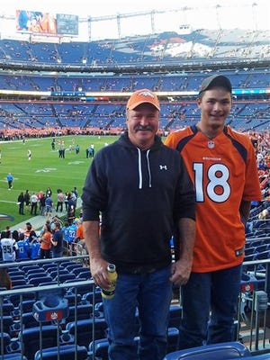 In this Oct. 23, 2014 photo provided by Jarod Tonneson, Paul Kitterman, left, and his stepson Jarod Tonneson pose for a photo during a San Diego Chargers-Denver Broncos football game at Sports Authority Field in Denver. A short time later, at halftime, Kitterman left his seat to meet friends and hasn't been seen since. Tonneson filed a missing-persons report with Denver police, scoured the sprawling stadium, called local hospitals and detox centers, and posted fliers around the city. Police said Tuesday, Oct. 28, 2014 that no new information about his whereabouts has emerged. (AP Photo/Courtesy Jarod Tonneson)