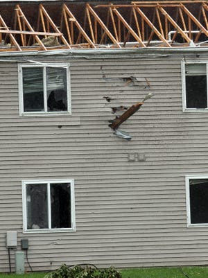 Debris lodged into the side of a Vinton apartment building after a brief tornado hit the community July 17.