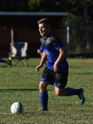 Zanesville's Aaron Ashby moves with the ball against Rosecrans. The senior midfielder signed with Ohio Dominican on Friday.