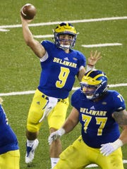 J.P. Caruso passes late in the fourth quarter of Delaware's 22-3 win over Delaware State in the 2017 opener while Mario Farinella works in protection.