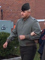 Gunnery Sgt. Joseph Felix enters court at Camp Lejeune,