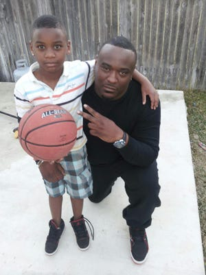 Javier Ambler II and his son J'Vaughn, shown in a family photo. Ambler died while in police custody in March 2019.