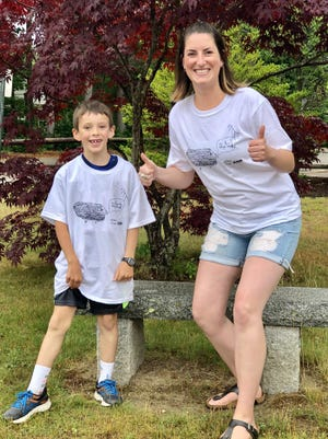 Will Healy, a third-grader at Portsmouth's Dondero School this past school year, won Haven's annual T-shirt design contest. He is joined by his teacher Faith Masterson.