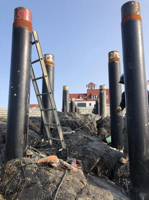 Pipes that will serve as the foundation of a pier were installed this week at the former life-saving station at Wood Island in Portsmouth Harbor.